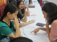 Thao, NGOF counselor, helping participants in a case study